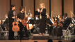 12 year-old Kevin Huang and 14 year-old Chris Monteverde acknowledging the applause by Executive Director and Conductor of The South Florida Youth Symphony Orchestra, Marjorie Hahn, at the close of a performance at Florida Memorial University.