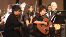 Keving Huang and Chris Monteverde performn as guitar soloists with members of The South Florida Youth Symphony Orchestra.