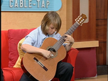 Jonathan Cabrera performs Asturias during a recording of  Cable television program Miami-Dade Connected, with host Johanna Gomez.
